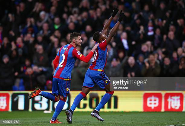 Wilfried Zaha of Crystal Palace celebrates scoring his team's third goal with his team mate Joel Ward during the Barclays Premier League match...