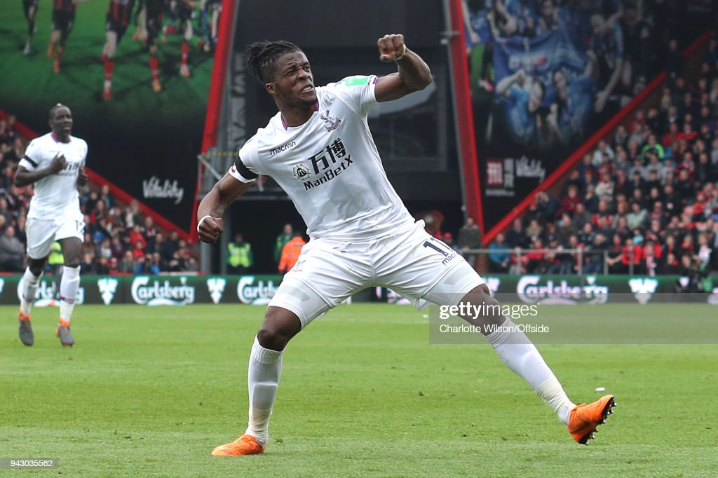 Wilfried Zaha of Crystal Palace celebrates scoring their 2nd goal during the Premier League match between AFC Bournemouth and Crystal Palace at Vitality Stadium on April 7, 2018 in Bournemouth, England.