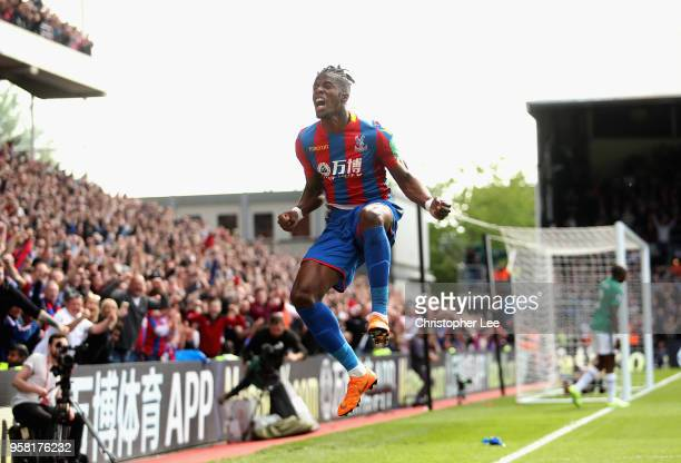 Wilfried Zaha of Crystal Palace celebrates scoring their first goal during the Premier League match between Crystal Palace and West Bromwich Albion...