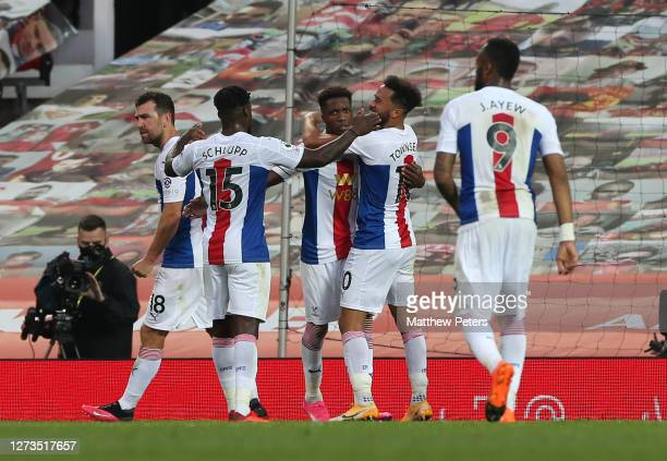 Wilfried Zaha of Crystal Palace celebrates scoring their second goal during the Premier League match between Manchester United and Crystal Palace at...