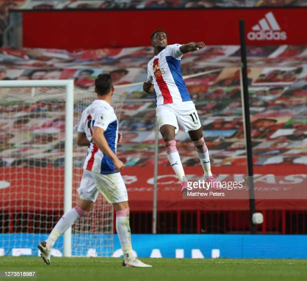Wilfried Zaha of Crystal Palace celebrates scoring their third goal during the Premier League match between Manchester United and Crystal Palace at...