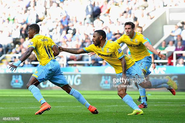 Wilfried Zaha of Crystal Palace celebrates scoring third goal with Jason Puncheon during the Barclays Premier League match between Newcastle United...