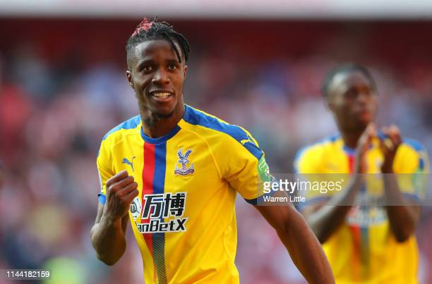 Wilfried Zaha of Crystal Palace celebrates victory after the Premier League match between Arsenal FC and Crystal Palace at Emirates Stadium on April...