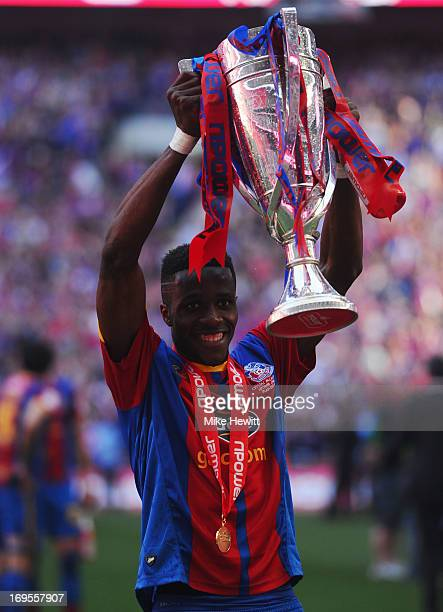 Wilfried Zaha of Crystal Palace celebrates victory with the trophy after the npower Championship Playoff Final match between Watford and Crystal...