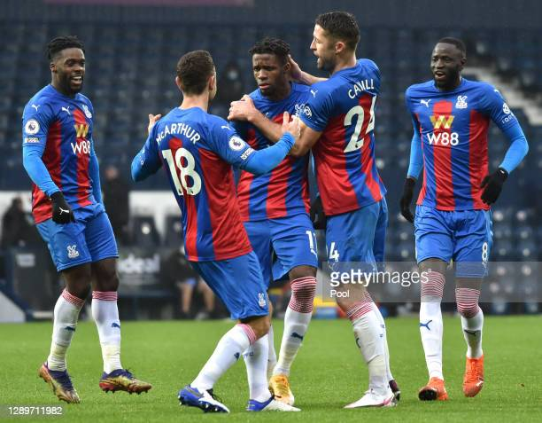 Wilfried Zaha of Crystal Palace celebrates with Gary Cahill and James McArthur after scoring their team's second goal during the Premier League match...