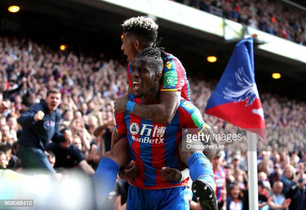 Wilfried Zaha of Crystal Palace celebrates with Patrick van Aanholt of Crystal Palace after scoring his sides second goal during the Premier League...