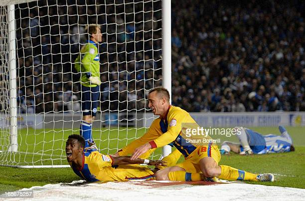 Wilfried Zaha of Crystal Palace celebrates with teammate Aaron Wilbraham after scoring his first goal during the npower Championship play off semi...