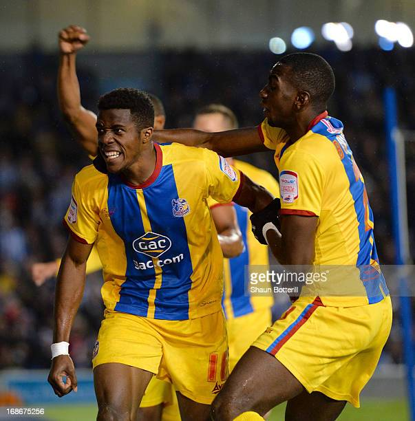 Wilfried Zaha of Crystal Palace celebrates with teammate Yannick Bolasie after scoring his first goal during the npower Championship play off semi...