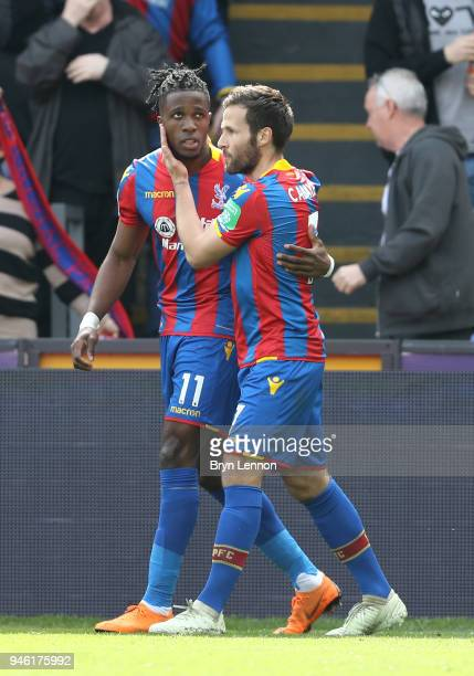 Wilfried Zaha of Crystal Palace celebrates with teammate Yohan Cabaye after scoring his sides first goal during the Premier League match between...