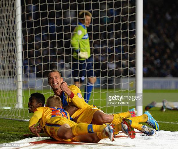 Wilfried Zaha of Crystal Palace celebrates with teammates Aaron Wilbraham and Dean Moxey after scoring his first goal during the npower Championship...