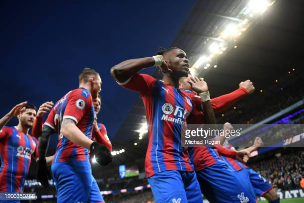 Wilfried Zaha of Crystal Palace celebrates with teammates after Fernandinho of Manchester City scored an own-goal which resulted in the second goal...