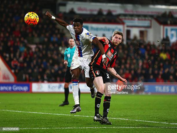 Wilfried Zaha of Crystal Palace challenges Eunan O'Kane of Bournemouth during the Barclays Premier League match between AFC Bournemouth and Crystal...