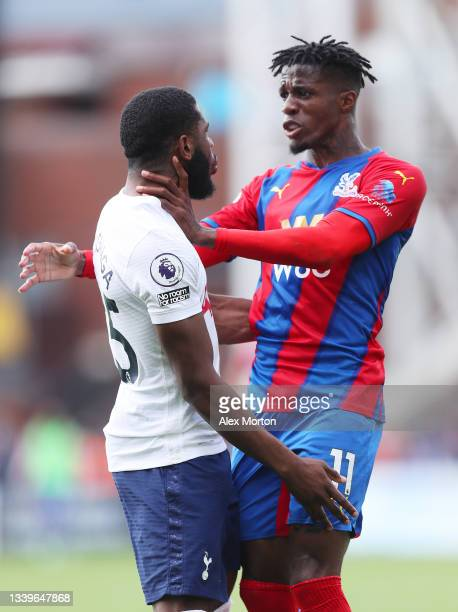 Wilfried Zaha of Crystal Palace clashes with Japhet Tanganga of Tottenham Hotspur during the Premier League match between Crystal Palace and...