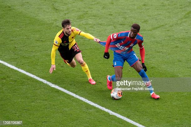 Wilfried Zaha of Crystal Palace competes for ball with Kiko Femenia of Watford FC during the Premier League match between Crystal Palace and Watford...