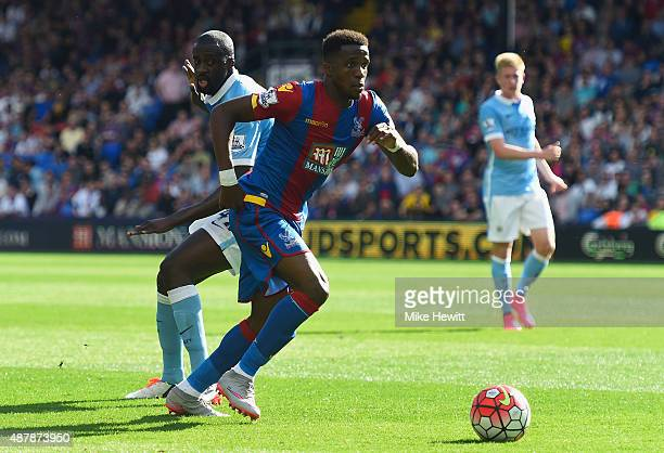 Wilfried Zaha of Crystal Palace evades Yaya Toure of Manchester City during the Barclays Premier League match between Crystal Palace and Manchester...