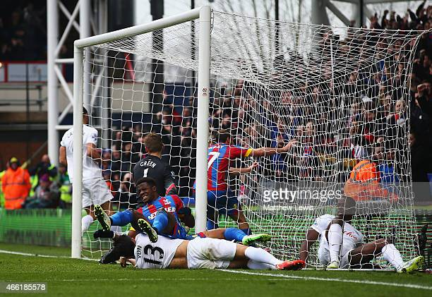 Wilfried Zaha of Crystal Palace grimaces after scoring the opening goal during the Barclays Premier League match between Crystal Palace and Queens...