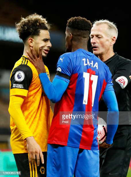 Wilfried Zaha of Crystal Palace handles Rayan Ait-Nouri of Wolverhampton Wanderers' face as they clash during the Premier League match between...