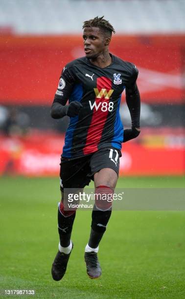 Wilfried Zaha of Crystal Palace in action during the Premier League match between Sheffield United and Crystal Palace at Bramall Lane on May 8, 2021...