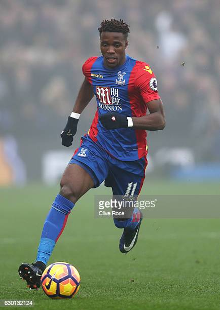 Wilfried Zaha of Crystal Palace in action during the Premier League match between Crystal Palace and Chelsea at Selhurst Park on December 17 2016 in...