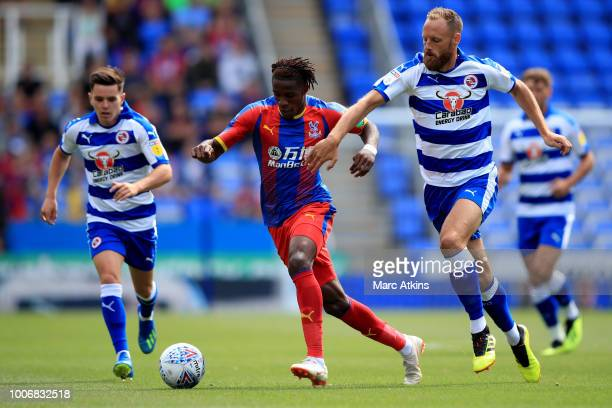 Wilfried Zaha of Crystal Palace in action with Liam Kelly and David Meyler of Reading during the PreSeason Friendly between Reading and Crystal...