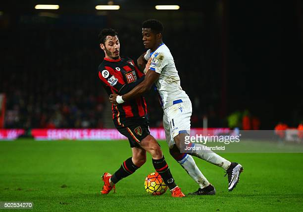 Wilfried Zaha of Crystal Palace is challenged by Adam Smith of Bournemouth during the Barclays Premier League match between AFC Bournemouth and...