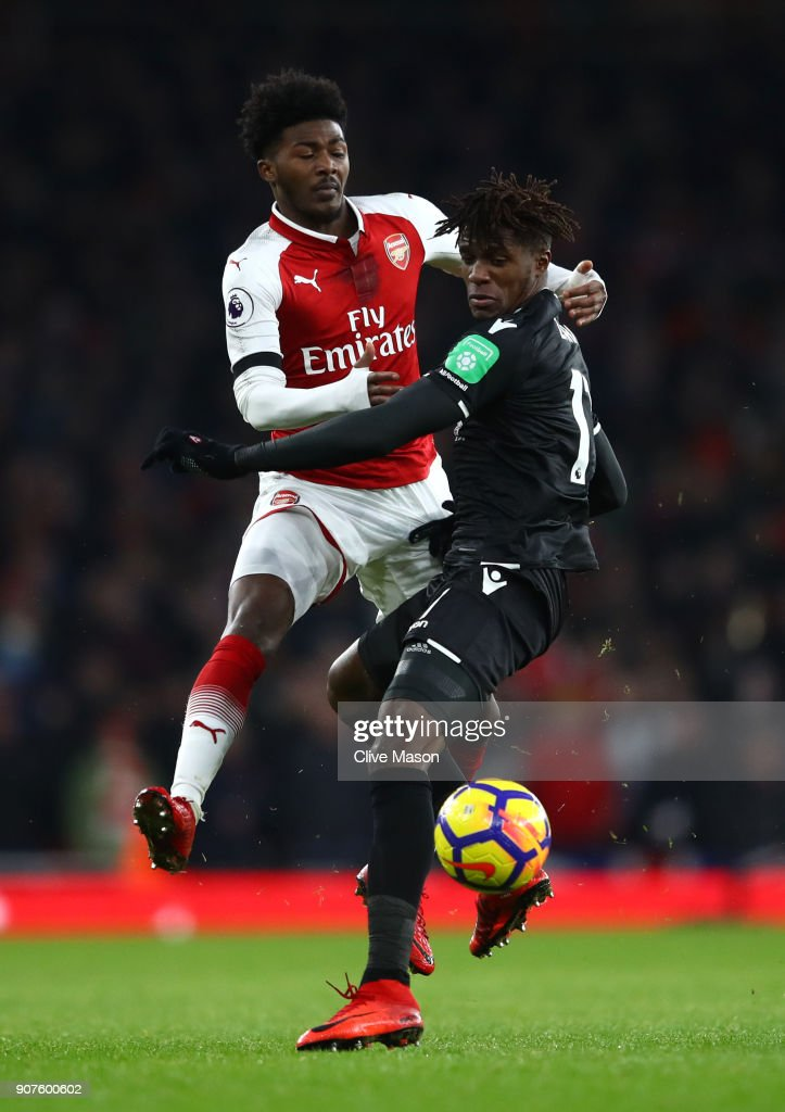 Wilfried Zaha of Crystal Palace is challenged by Ainsley Maitland-Nles of Arsenal during the Premier League match between Arsenal and Crystal Palace at Emirates Stadium on January 20, 2018 in London, England.