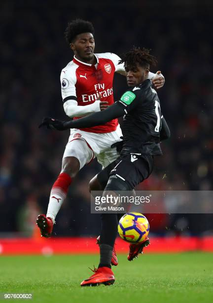 Wilfried Zaha of Crystal Palace is challenged by Ainsley MaitlandNles of Arsenal during the Premier League match between Arsenal and Crystal Palace...