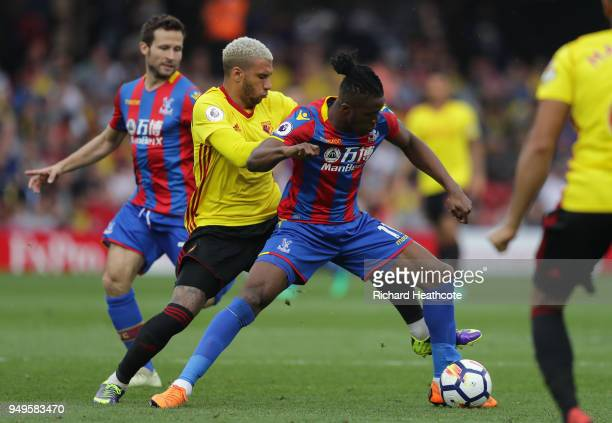 Wilfried Zaha of Crystal Palace is challenged by Etienne Capoue of Watford during the Premier League match between Watford and Crystal Palace at...