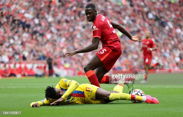 Wilfried Zaha of Crystal Palace is challenged by Ibrahima Konate of Liverpool during the Premier League match between Liverpool and Crystal Palace at...