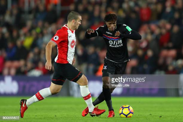 Wilfried Zaha of Crystal Palace is challenged by Oriol Romeu of Southampton during the Premier League match between Southampton and Crystal Palace at...