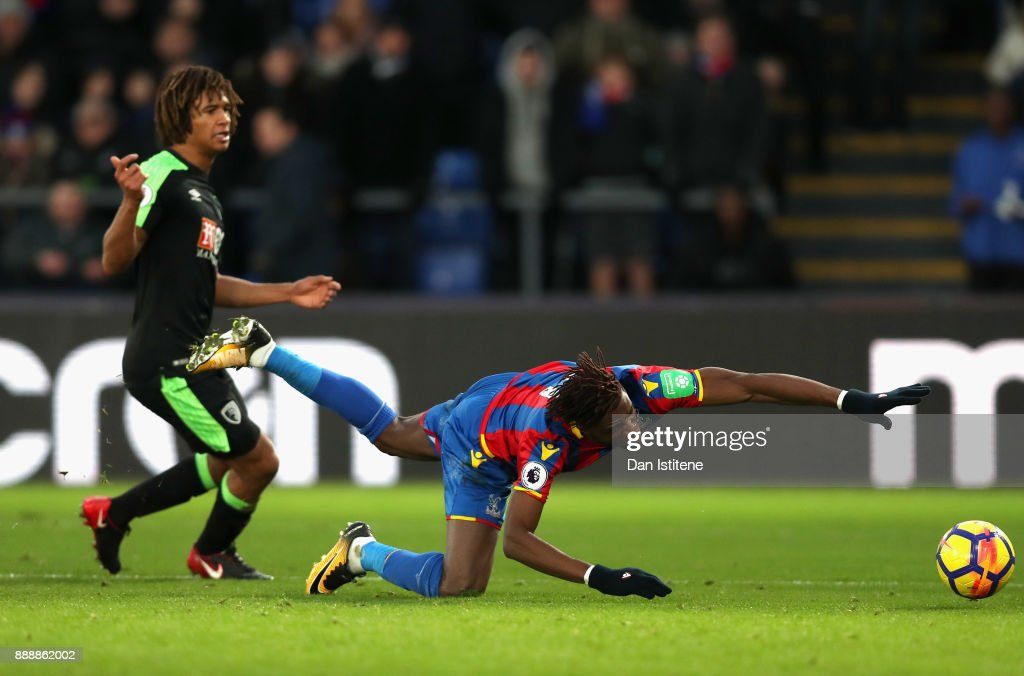 Wilfried Zaha of Crystal Palace is fouled and penalty is awarded during the Premier League match between Crystal Palace and AFC Bournemouth at Selhurst Park on December 9, 2017 in London, England.
