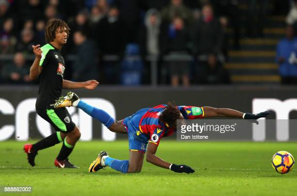 Wilfried Zaha of Crystal Palace is fouled and penalty is awarded during the Premier League match between Crystal Palace and AFC Bournemouth at...