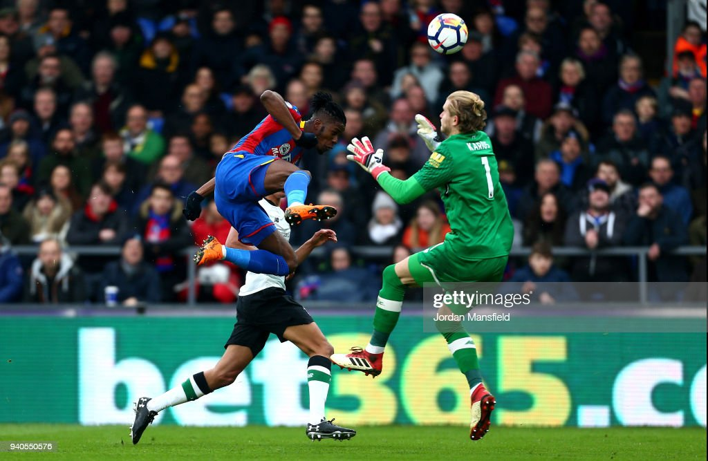 Wilfried Zaha of Crystal Palace is fouled by Loris Karius of Liverpool which leads to a penalty being awarded during the Premier League match between Crystal Palace and Liverpool at Selhurst Park on March 31, 2018 in London, England.