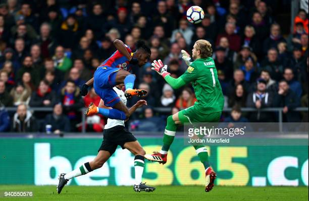 Wilfried Zaha of Crystal Palace is fouled by Loris Karius of Liverpool which leads to a penalty being awarded during the Premier League match between...