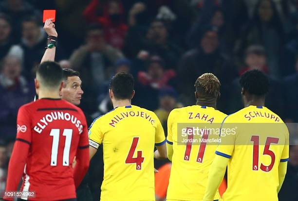 Wilfried Zaha of Crystal Palace is shown a red card by Match Referee Andre Marriner during the Premier League match between Southampton FC and...