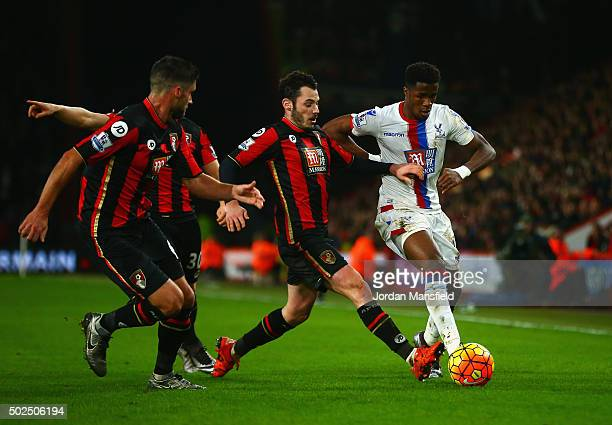 Wilfried Zaha of Crystal Palace is tackled by Adam Smith of Bournemouth during the Barclays Premier League match between AFC Bournemouth and Crystal...