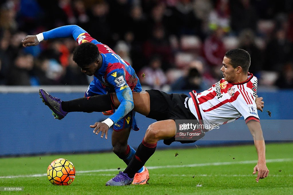 Wilfried Zaha of Crystal Palace is tackled by Jack Rodwell of Sunderland during the Barclays Premier League match between Sunderland and Crystal Palace at Stadium of Light on March 1, 2016 in Sunderland, England.