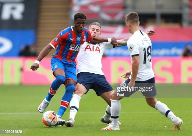 Wilfried Zaha of Crystal Palace is tackled by Toby Alderweireld and Giovani Lo Celso both of Tottenham Hotspur during the Premier League match...