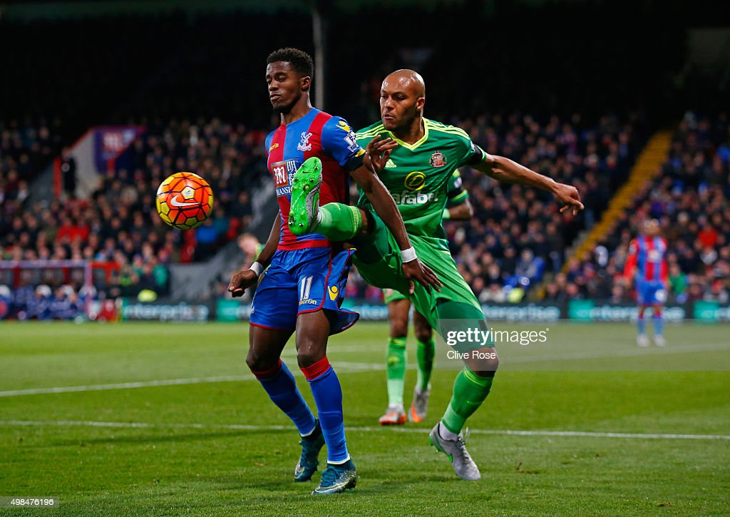 Wilfried Zaha of Crystal Palace is tackled by Younes Kaboul of Sunderland during the Barclays Premier League match between Crystal Palace and Sunderland at Selhurst Park on November 23, 2015 in London, England.