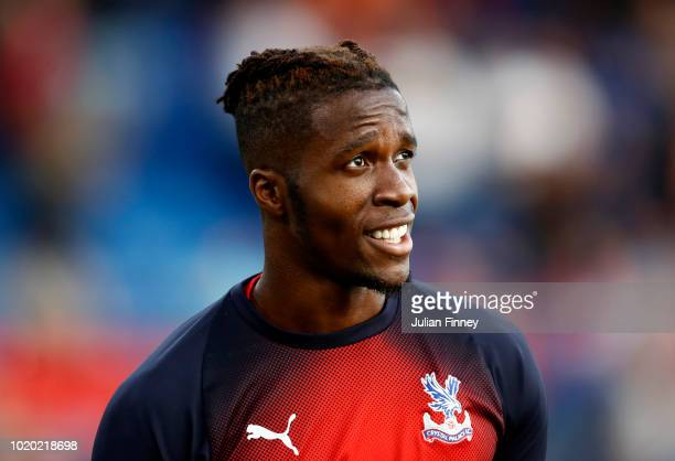 Wilfried Zaha of Crystal Palace looks on during the Premier League match between Crystal Palace and Liverpool FC at Selhurst Park on August 20 2018...
