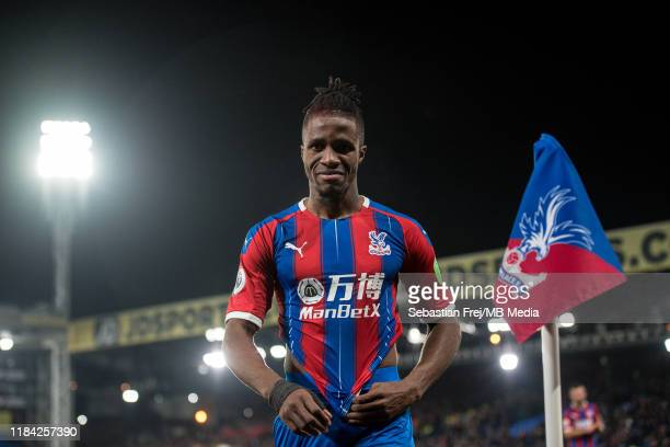 Wilfried Zaha of Crystal Palace looks on during the Premier League match between Crystal Palace and Liverpool FC at Selhurst Park on November 23 2019...