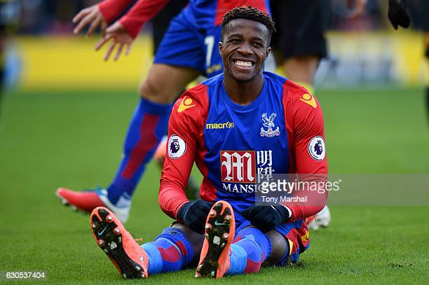 Wilfried Zaha of Crystal Palace reacts after a challenge during the Premier League match between Watford and Crystal Palace at Vicarage Road on...