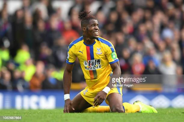 Wilfried Zaha of Crystal Palace reacts during the Premier League match between Everton FC and Crystal Palace at Goodison Park on October 21 2018 in...