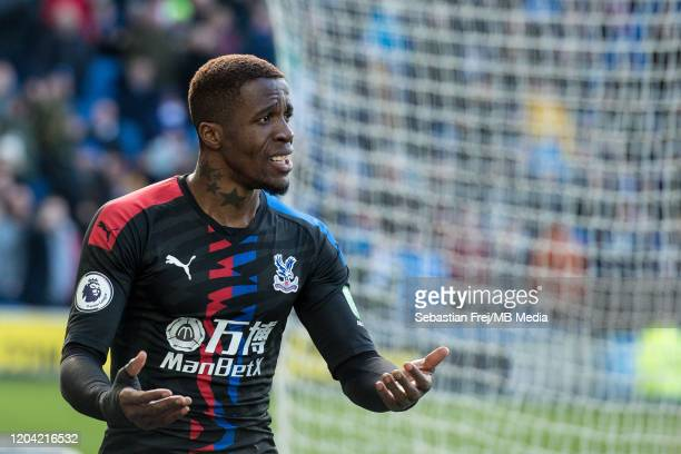 Wilfried Zaha of Crystal Palace reacts during the Premier League match between Brighton Hove Albion and Crystal Palace at American Express Community...
