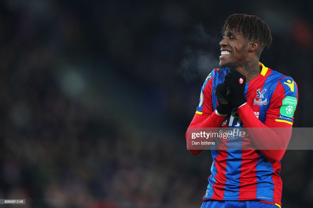 Wilfried Zaha of Crystal Palace reacts during the Premier League match between Crystal Palace and Arsenal at Selhurst Park on December 28, 2017 in London, England.