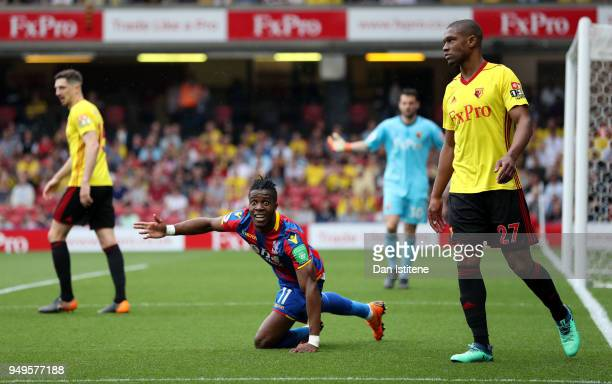 Wilfried Zaha of Crystal Palace reacts during the Premier League match between Watford and Crystal Palace at Vicarage Road on April 21 2018 in...