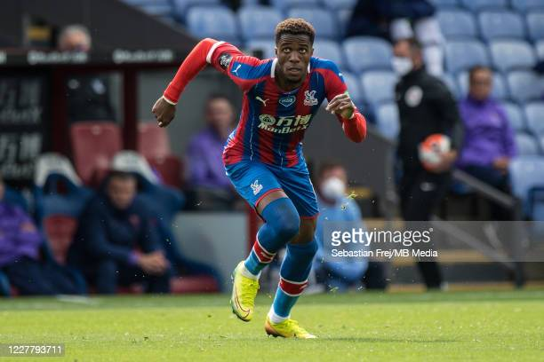 Wilfried Zaha of Crystal Palace runs during the Premier League match between Crystal Palace and Tottenham Hotspur at Selhurst Park on July 26 2020 in...