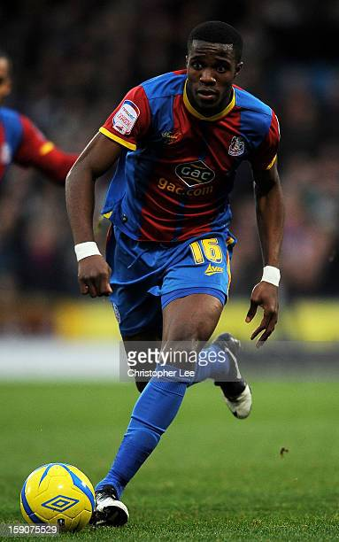 Wilfried Zaha of Crystal Palace runs with the ball during the FA Cup with Budweiser Third Round match between Crystal Palace and Stoke City at...