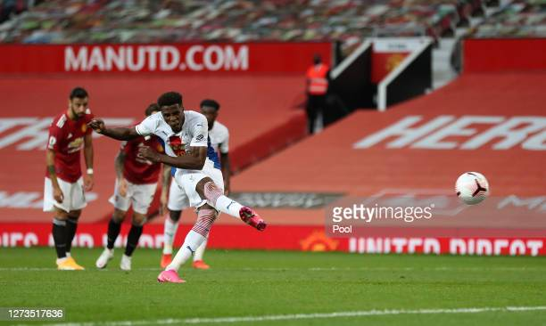 Wilfried Zaha of Crystal Palace scores a penalty for his team's second goal during the Premier League match between Manchester United and Crystal...