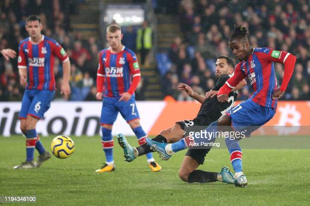Wilfried Zaha of Crystal Palace scores his sides first goal during the Premier League match between Crystal Palace and Brighton Hove Albion at...